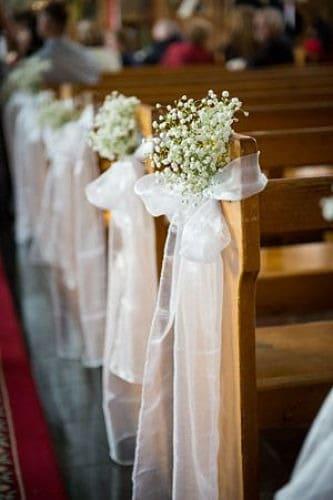 Paniculata y lazo en banco de iglesia